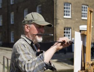 Image of Jonny Walsom painting on location