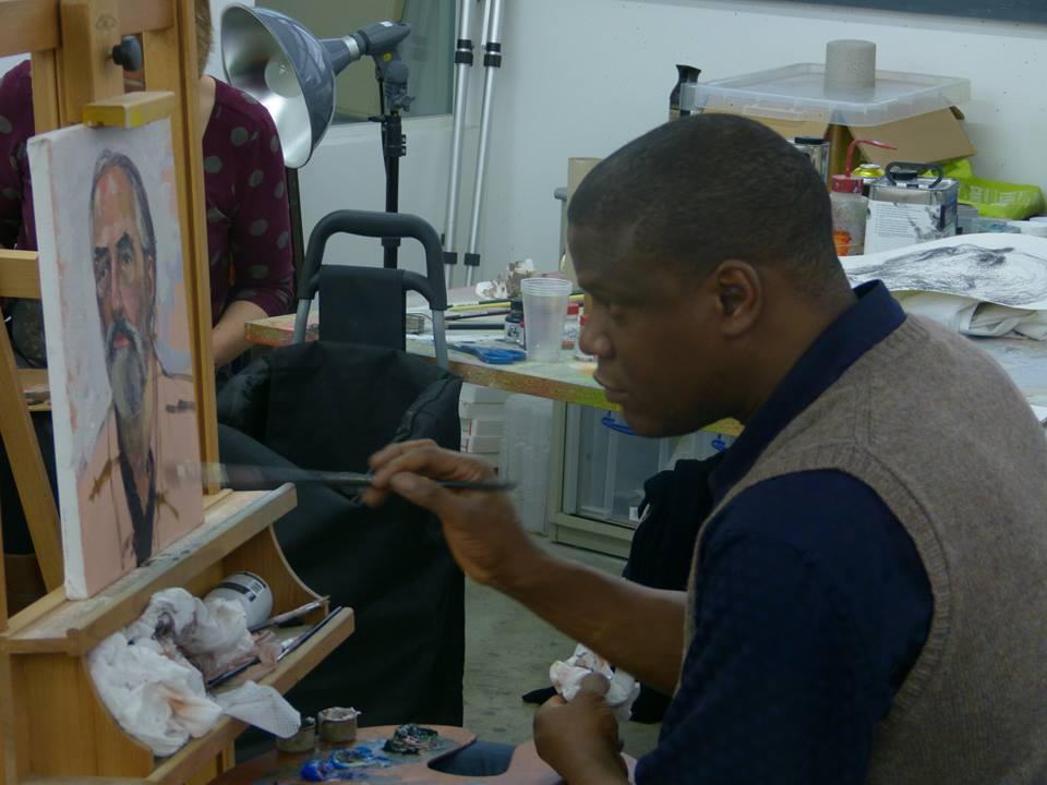 Image of Adebanji Alade VPROI painting a portrait