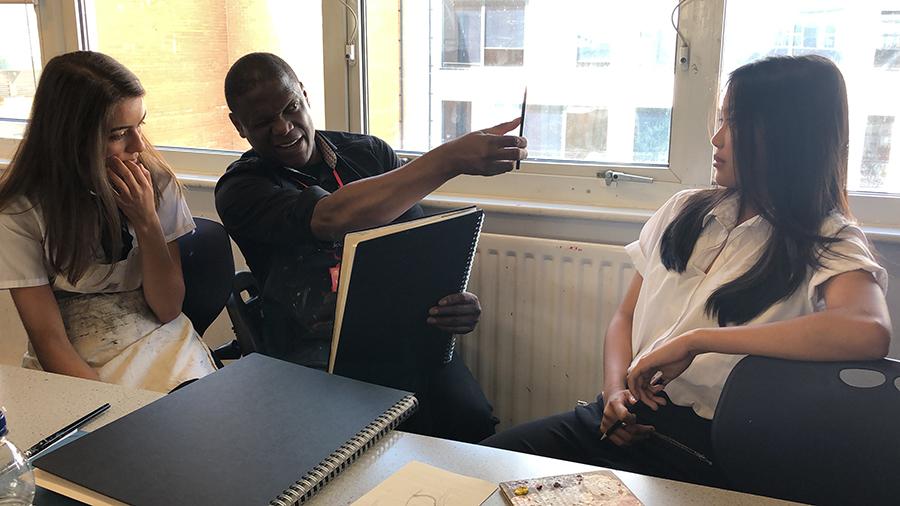 Adebanji Alade working with pupils at Cardinal Wiseman