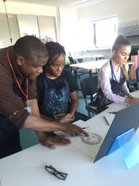 Adebanji Alade working with pupils on the educational outreach programme