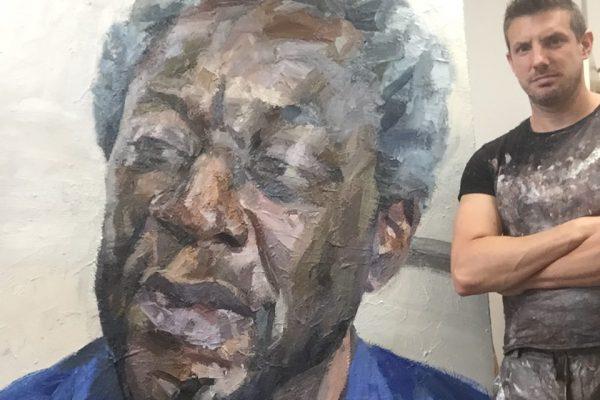 Tim Benson PROI with his painting 'Agenda Brown, photographer, Tottenham'