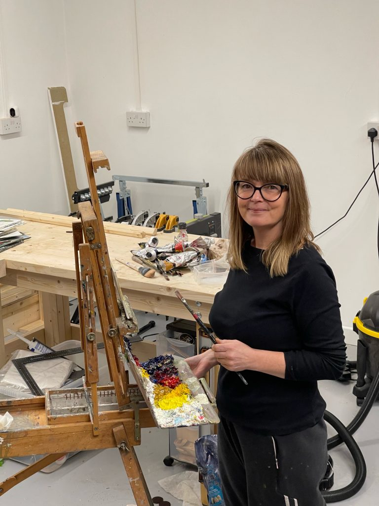 Image of Amanda Coleman painting at the easel