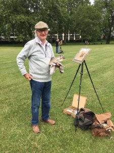 Person painting in Green Park, London