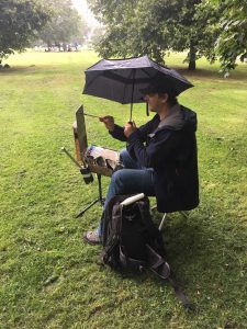 Another hardy painter with an umbrella