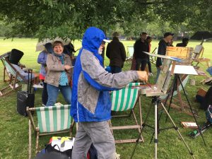 Tim King hard at it painting in the rain!